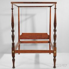 ine Carved Mahogany and Birch Canopy Bed, Salem, Massachusetts, c. 1815-20, the vase- and ring-turned, reeded, waterleaf- and bellflower-carved foot posts continuing to vase- and ring-turned legs, joined to the tapering pencil head posts by a flat tester frame and peaked headboard, refinished, ht. 84, wd. 48, lg. 72 3/4 in.