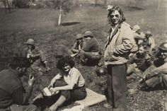 Q57123 - Harriett Pinkston Engelhardt and another Red Cross worker in a field where soldiers are seated during a break. (ADAH)