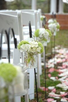 primera comunion guatemala la barra dulce + the white and green flower arrangments hanging on white chairs allows the colorful blossoms on the aisle to stand out
