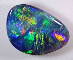 VERY BRIGHT BLACK OPAL - 7.65 CTS - STRAW PATTERN