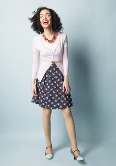 In this outfit: On Crop of the World Top in White, Instantly Impressive Necklace, Modern Romance Skirt in  Navy Foliage, Charter School Cardigan