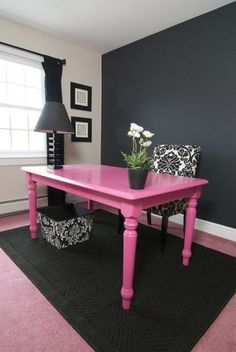 Replace with red table and hang an arrangement of black and white photos on back chalkboard wall.