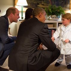 The future king of England meets the present leader of the free world in his PJs and a cute robe. :-D