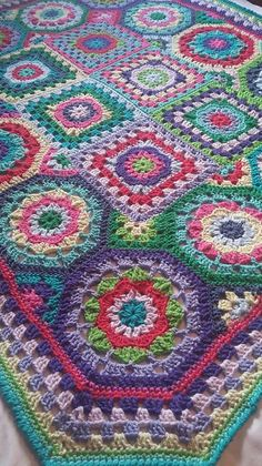 In Love with Color Throw by Jessie Rayot - this pattern is available for free via Ravelry.. This particular project: Kirstenlynn's Colorful Blanket