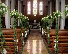 Church Wedding Decorations - white roses with ruscus and sprengeri (aspargus) fern