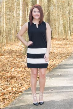 This darling LBD is equal parts classy and sassy! The ivory color block bottom and exposed gold zipper gives this dress an extra dose of sass.