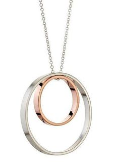 "A modern twist to the classic circle necklace, these two nested circles move freely while the subtle contrast of silver and rose gold creates an eye catching pop of color. Outside circle measures approximately 1 inch, and the inside circle 1/2 inch. Necklace chain is 17"" but custom lengths are gladly accommodated. Sterling silver paired with 14K rose gold vermeil. Made by hand in San Francisco. * Our artisan jewelry pieces are handcrafted to order and generally ship in 1 week or less, but…"