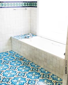 Bathroom interior with white zellige tiles cladding wall and bathtub and blue patterned cement tiles decorating the floor. Decorative floor and wall tiles from Mosaic Factory Moroccan Tiles Kitchen, Kitchen Tiles, Wall And Floor Tiles, Wall Tiles, Bathtub Tile, Tile Showroom, Tile Manufacturers, Encaustic Tile, Floor Decor
