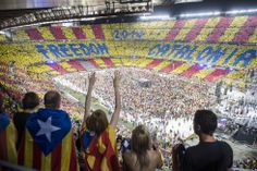 Barcelona, Catalonia, June 29, 2013. Attendees 'per la Llibertat Concert' (Concert for Freedom), which brought together over 90,000 people in the Camp Nou in another show of strength of independence. This is a poster with the organizers of the concert (Omnium Cultural, an organization that promotes Catalan sovereignism) claimed the right to independence of Catalonia.