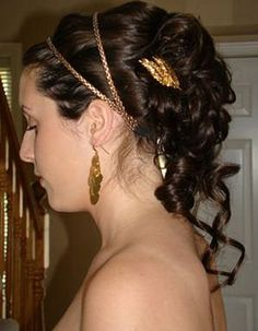 Headband is pretty, suits the theme more, i like the wisps of hair trailing down the back