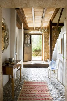 Gorgeous beams and textured floor.