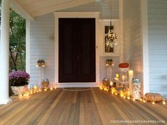 Decorating our Victorian porch for Halloween… I used mason jars with tea lights and made a DISCO chandelier.