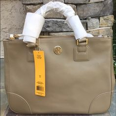 """Tory Burch Robinson Double Zip Tote (ORIGINAL/NEW) This 100% AUTHENTIC Tory Burch Classic Robinson tote is in its original packaging and has never been used. Original dust bag is included. 1st Edition Robinson. Rare and no longer sold in stores.  Saffiano leather with golden hardware. Removable, adjustable crossbody strap. Snap top; front and back zip-top pockets. Signature Tory Burch double-T logo medallion. Inside, two open pockets. Orange lining. Metal feet protect bottom. 10 1/2""""H x 15""""W…"""