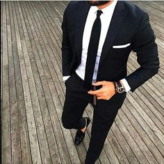 black suit white shirt. Classic look that anyone can pull off.