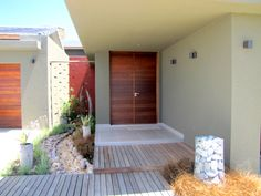 Earp Construction develops and sells properties in George on the Garden Route in South Africa. There are a range of design styles and sizes to suit your budget. Golf Estate, Open Living Area, Wooden Decks, Property For Sale, South Africa, Swimming Pools, Construction, Patio, Outdoor Decor
