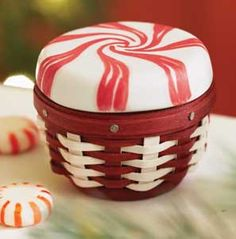 Longaberger Baskets-Collectors Club Miniature Sweets Peppermint Basket. Another wonderful interpretation of a traditional favorite American candy, the Miniature Sweets Peppermint Basket features an impossibly small basket topped by a hand-painted ceramic lid. Includes Basket and Pottery Topper. Made in America. www.shopbasketsnmore.com