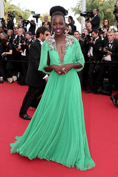 As she tends to do, Nyong'o shuts down the red carpet in this free-flowing, bright green Gucci gown.   - MarieClaire.com