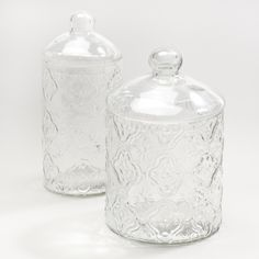 Adorn your home with the beauty of clear glass. Our simply elegant Clear Tile Glass Canister completes any bathroom décor with an alluring sparkle. Perfect for storing cotton balls or swabs, you'll love adding a classic touch with these glass canisters.