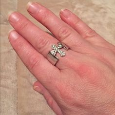 ⭐️Premier Designs Ring⭐️ This cross ring is made by Premier Designs. Sterling silver with Rhodium. CZ crystal accents. It is a size 6, only worn a few times. LIKE NEW AND AUTHENTIC!PLEASE NO LOW BALLING Premier Designs Jewelry Rings