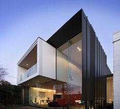 Ultra Modern Glazed Modern Architecture Homes With Black Wall And Floating Balcony In Upper Level With Large Window Glass