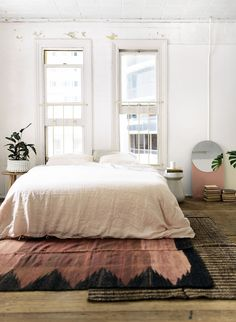 I've amassed an excessivecollection of smallTurkish kilims andethnic, handwovenrugs over the years - all of which are just piling up in a storage closet. I can't help it, I'm addicted to textiles! And now that most of our neutral colored area rugs are in place throughout the home, it's time