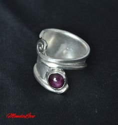 Check out this item in my Etsy shop https://www.etsy.com/uk/listing/498694153/rubystar-adjustable-ring