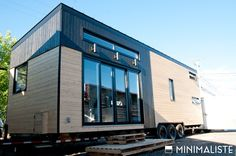 "The ""Le Chene"" (The Oak) tiny house from Minimaliste Tiny Houses. A beautiful 300 sq ft home with a warm and roomy interior."