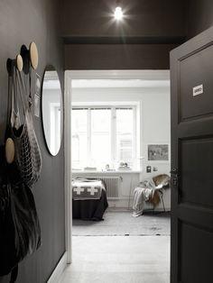 Dark grey / black hallway. Via LA COOL & CHIC