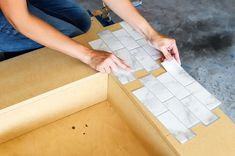 No fireplace? Check out how you can make your own renter-friendly DIY faux fireplace with peel and stick tiles available at The Home Depot! Faux Mantle, Faux Fireplace Mantels, Wooden Fireplace, Brick Fireplace Makeover, Built In Around Fireplace, Rental Home Decor, Smart Tiles, Hanging Artwork, Candy Christmas Decorations