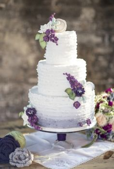 Wedding Cake: Purple flower adorned cake | Photo by: Jade and Matthew Take Pictures on Smitten Magazine via Lover.ly