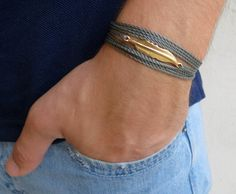 "Men's Bracelet - Men's Feather Bracelet - Men's Gray Bracelet - Men's Jewelry - Bracelets For Men - Jewelry For Men - Gift for Him  Looking for a gift for your man? You've found the perfect item for this!   The simple and beautiful bracelet combines gray wax wire which wrap on hand and a gold filled feather pendant.  Length: 33"" (85 cm) + 2"" (5 cm) extension chain.  $24"