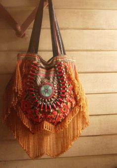 Hippie Fringe purse bag // tribal // ethnic // embroidery bag // gold // gypsy // boho // slouchy // textile // handbag. $69.00, via Etsy.