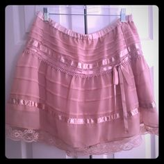 🎀 Pink Ribbon & Lace H&M Skirt. Elastic waist! On Wednesdays we wear Pink! 💕🎀.      Ribbon and Lace adorn this like brand new skirt! Fabulous and girly for any skirt collector 🎀                                                                        18 inches long.                                                            Elastic Waist stretches to 19/20 inches.                            Excellent pristine condition and freshly washed. Perfect to dress up or down! Girly, classy, sexy…