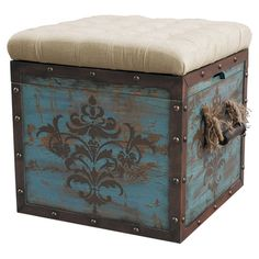 Distressed hardwood cube ottoman with a reversible tray/cushion top and hand-painted damask-inspired details.   Product: Cube ot...