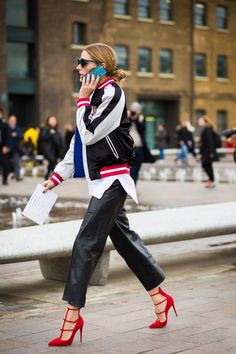 Olivia Palermo wears a bomber jacket with leather culottes and red Christian Louboutin pumps