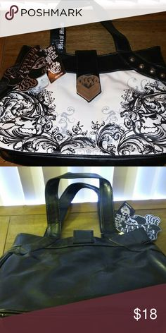 METAL MULISHA PURSE -NWT NEW WITH TAGS. BLACK w/ Metal Mulisha in White on front. Plain black back. Slip and zipper pocket in interior. Metal Mulisha Bags Shoulder Bags