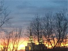 A stunning sunset behind the Temple in Kansas City's Northland