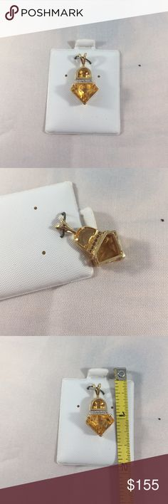14k yellow gold. Citrine pendant Really nice pendant it has 6 small diamonds above the citrine Jewelry Necklaces