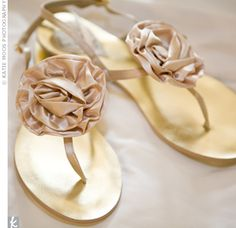 Rachel walked barefoot on the beach for the ceremony, so she couldn't wear heels to the reception without re-hemming her dress. Instead, she slipped on champagne-colored flats.