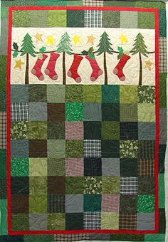 Cute banner where the pillows go. How fun would it be for the kids to each have a Christmas quilt to use only in December!