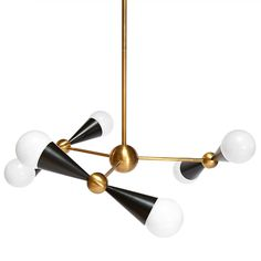 Kinetic Modernism.Simple geometric shapes—cones and spheres—collide with dynamic results in our Caracas Six-Light Chandelier. Antiqued and blac