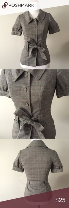 """Guess Short Sleeve Plaid Belted Bow Blazer Like new condition. Only worn once. 21"""" long from top of shoulder to hem. 14"""" across chest laid flat. Gray and pink plaid pattern. Two functional front pockets. Button-up. Removable tie bow belt. Silky pink lining. Guess Jackets & Coats Blazers"""