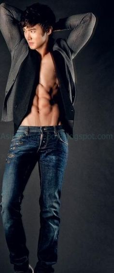 Siwon from Super Junior. I would like to wash myself on those abs!