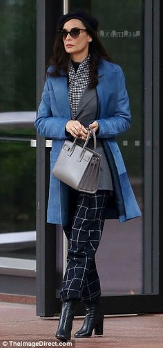It's a match: The star's wardrobe this day also included a grey blazer, checkered scarf and beret