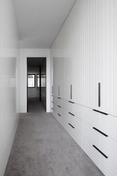 Lose the useless top section by putting drawers underneath 👌🏻👌🏻👌🏻 Walk in robe joinery covered in white painted v-groove boards. Direction is vertical on doors and horizontal on drawers at Park Street Residence by B.E Architecture Wardrobe Doors, Bedroom Wardrobe, Built In Wardrobe, Wardrobes For Bedrooms, Walk In Wardrobe Design, Wardrobe Wall, Closets, Hallway Storage, Bedroom Storage