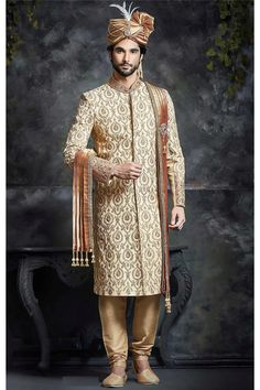 The sheer ethnic sophostication is radiated through this exclusive set of designer attire consisting of cream color silk fabricated wedding sherwani for Groom, this wedding sherwani is ornated finely with resham and thread work over all in traditional way, stand neck with resahm thread and beads wotk, you can paired with chudidhar bottom.