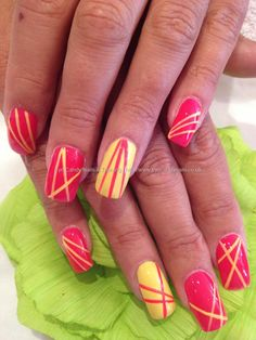 Using thin strips of Scotch Magic Tape, create a funky pattern for your nail polish