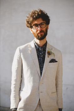 unconventional groom. suit men grooms floral jacket. linen suit. floral tie. floral shirt. sable.
