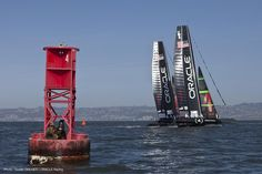 spectators on red buoy (photo: Guilain GRENIER / ORACLE Racing)
