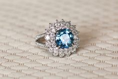 Vintage-Inspired, Split-Shank Ring with Blue Center Stone | Photography: Bob & Dawn Davis Photography. Read More: https://www.insideweddings.com/news/planning-design/how-to-achieve-a-ravishing-something-blue-color-palette/1969/